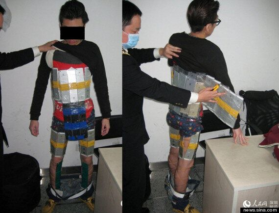 Chinese Smuggler Caught 'Wearing' 94