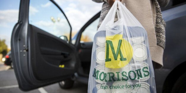 LONDON, ENGLAND - OCTOBER 02: A customer places Morrisons shopping bags in their car on October 2, 2014...
