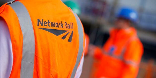 File photo dated 09/10/2013 of workers wearing Network Rail vests. A second rail workers union is holding...