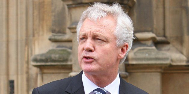 David Davis is pictured outside the House Of Commons in London this afternoon where he announced his...
