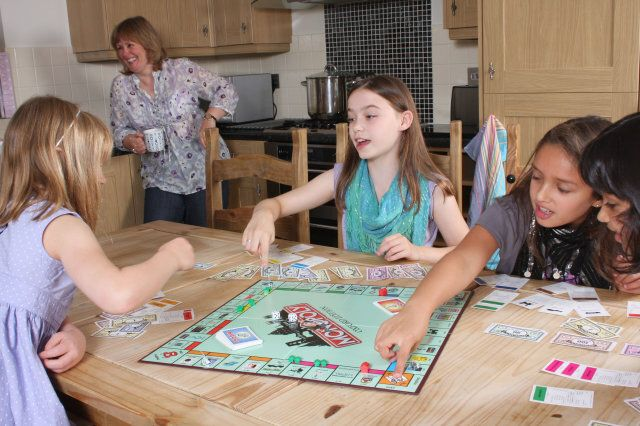 Children playing Monopoly.