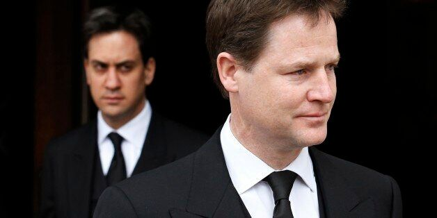 Britain's deputy prime minister, Nick Clegg (R), and leader of the opposition Labour party, Ed Miliband,...