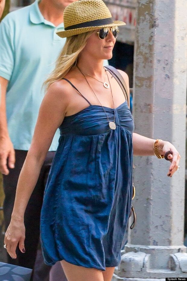 In The Navy: Jennifer Aniston Hits New Film Set In Pretty Puffball