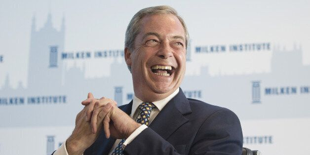 Nigel Farage, leader of the U.K. Independence Party (UKIP), reacts as he listens during the Milken Institute...