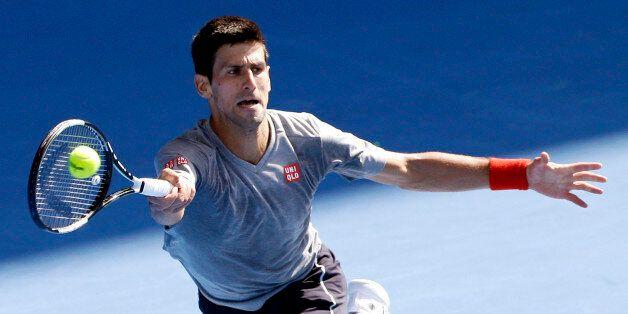 Novak Djokovic of Serbia returns a forehand shot during a training session at the Australian Open tennis championship in Melbourne, Australia, Sunday, Jan. 18, 2015. (AP Photo/Lee Jin-man)