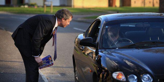 WINSLOW, ENGLAND - APRIL 08: United Kingdom Independence Party (UKIP) member Nigel Farage talks to a...