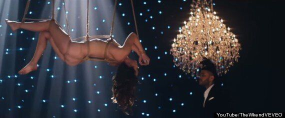 'Fifty Shades Of Grey' Star Dakota Johnson Stars In The Weeknd's (NSFW) 'Earned It' Music Video