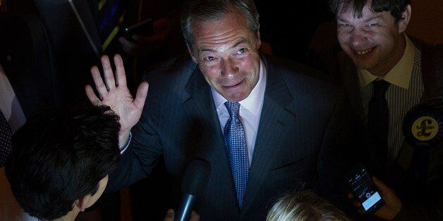 UK Independence Party (UKIP) leader Nigel Farage (C) waves as he speaks to the media at the Southampton...