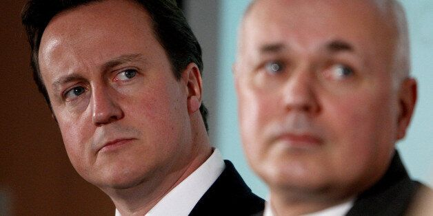 Conservative Party leader David Cameron, left, and former leader Iain Duncan Smith listen to information...