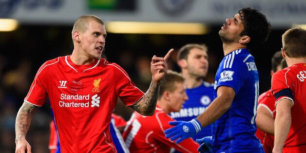 LONDON, ENGLAND - JANUARY 27: Martin Skrtel of Liverpool clashes with Diego Costa of Chelsea during the...