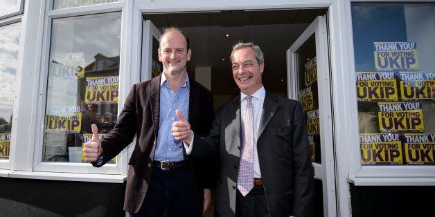 Newly-elected UK Independence Party (UKIP) MP Douglas Carswell (L) and party leader Nigel Farage pose...