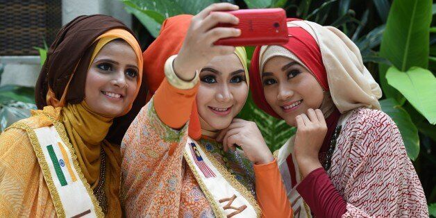 From L-R: Nazreen of India, Nur Khairunnisa of Malaysia, and Lulu Susanti of Indonesia, three of the...
