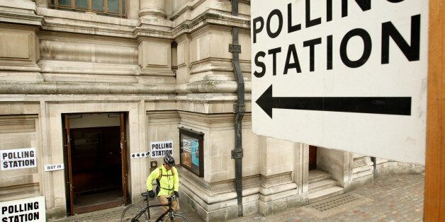 A voter leaves the polling station at the Methodist Central Hall in Westminster, central London, shortly...