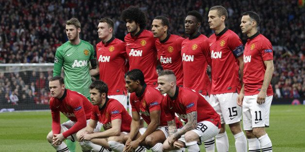 Manchester United players pose for a team photo prior to the Champions League quarterfinal first leg...