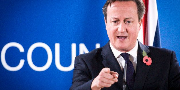 Britain's Prime Minister David Cameron speaks during a press conference after the second day of the heads...
