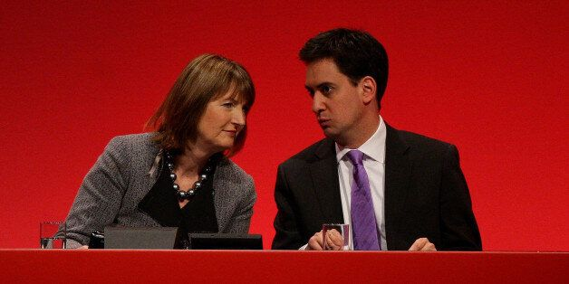 New Labour party leader Ed Miliband and deputy leader Harriet Harman on stage during the opening of the...