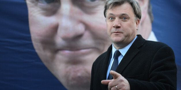Shadow chancellor Ed Balls unveils Labour's new poster marking the government's reduction in the 50p...