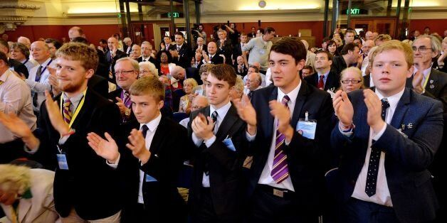 A front row of young supporters applaud as Nigel Farage, the Leader of UKIP (UK Independence Party),...