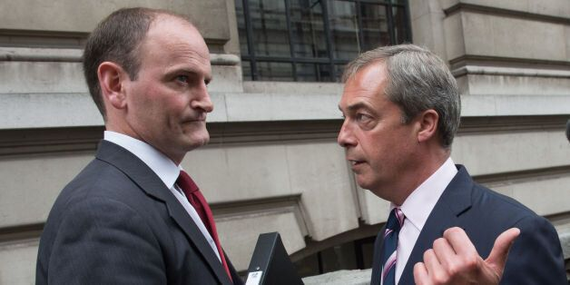 UKIP leader Nigel Farage (right) with Douglas Carswell after a press conference in central London where...