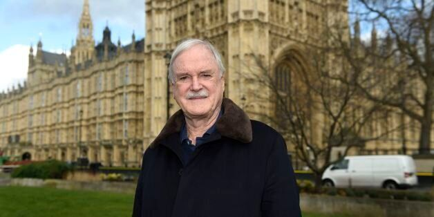 Actor and comedian John Cleese poses for a photograph on College Green outside the Houses of Parliament...
