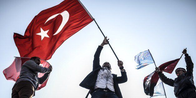 Supporters of Turkey's main opposition Republican People's Party (CHP) wave Turkish and party flags during...