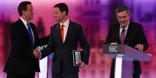 British opposition Conservative party leader, David Cameron (L), shakes hands with opposition Liberal...