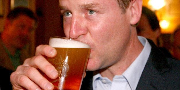 Liberal Democrat leader Nick Clegg enjoys a pint at the Nags Head in Malvern, Worcestershire, during...