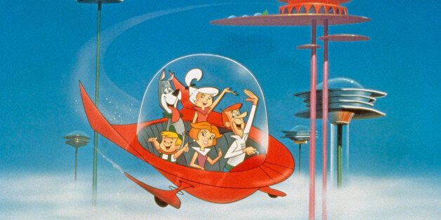The Jetson family wave as they fly past buildings in space in their spaceship in a still from the animated...