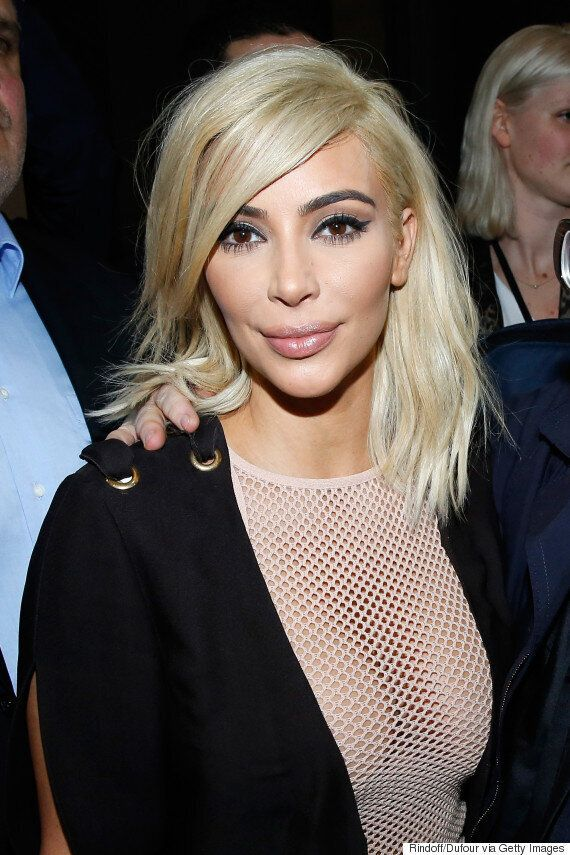 Kim Kardashian Forgets Her Bra As She Steps Out At Paris Fashion Week In Transparent Mesh Dress