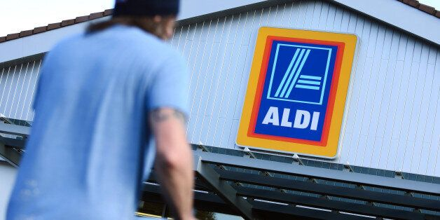 A customer pushes a shopping cart towards the entrance of an Aldi discount supermarket, operated by Aldi...