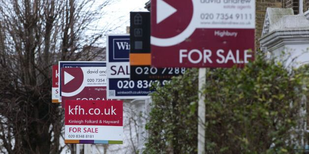 File photo dated 27/01/14 of for sale signs displayed outside houses in Finsbury Park, North London....