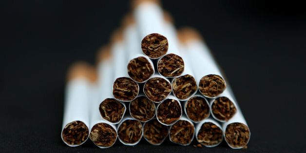 File photo dated 18/03/14 of cigarettes as the tobacco industry is financially linked to the majority...