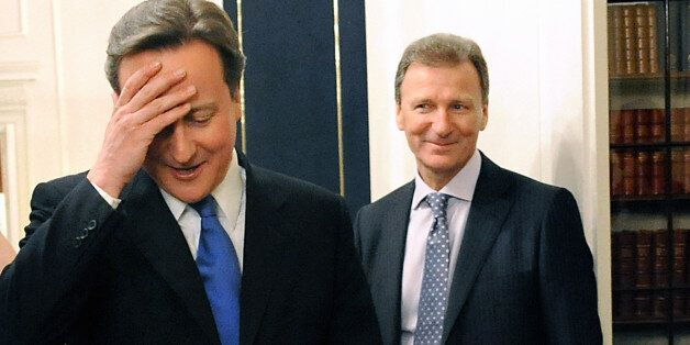 David Cameron and meets Cabinet Secretary Gus O'Donnell in the Cabinet Room of 10 Downing Street, London,...