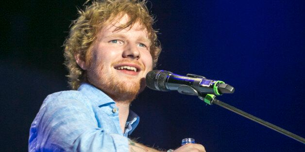 DUBAI, UNITED ARAB EMIRATES - MARCH 05: Ed Sheeran performs on stage at Media City Amphitheatre on March 5, 2015 in Dubai, United Arab Emirates. (Photo by Helen Boast/Redferns via Getty Images)