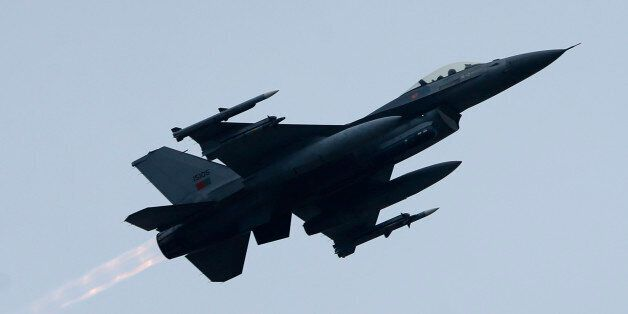Portugal's F-16 Falcons jet fighter flies over Siauliai airbase during the NATO's Baltic Air Policing...