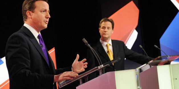 File photo dated 22/04/10 of Conservative leader David Cameron (left) speaking as Lib Dem leader Nick...