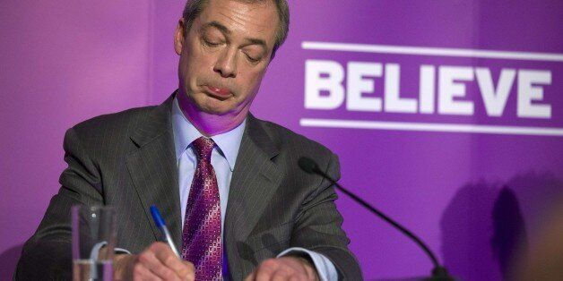 Britain's UKIP party leader Nigel Farage answers questions from the media at the Movie Starr Cinema in...