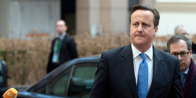 British Prime Minister David Cameron, center, arrives for an EU summit in Brussels on Thursday, Feb....