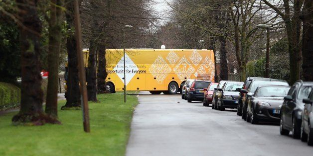 ABINGDON, ENGLAND - MARCH 29: The Liberal Democrat's battle bus negotiates a tight turn as it arrives...