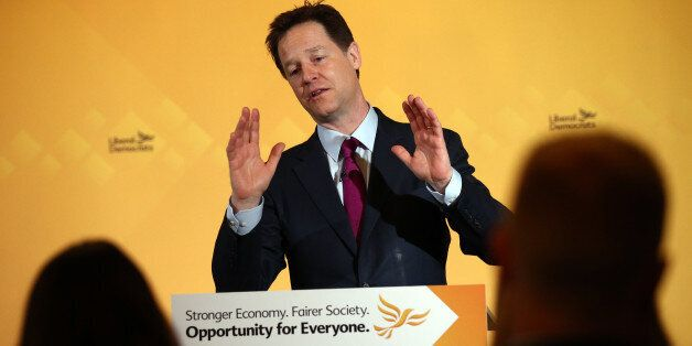 LONDON, ENGLAND - MARCH 31: Nick Clegg, the leader of the Liberal Democrat party, raises his hands while...