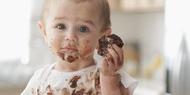 Messy Hispanic baby eating