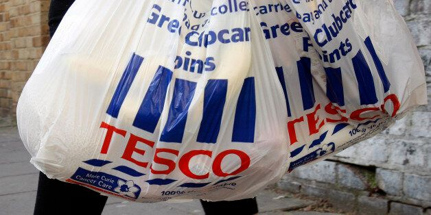 Tesco shopping bags are carried in London, Tuesday, April 21, 2009. Tesco PLC, Britain's largest retailer...