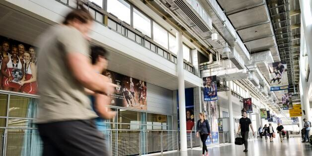 File photo dated 08/04/15 of people walking down the main concourse in the sports science building at...