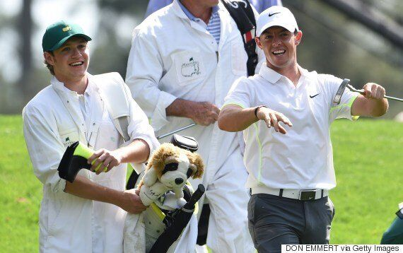 One Direction's Niall Horan Takes A Tumble While Golf Caddying For Rory McIlroy