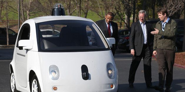 Google's Chris Urmson (R) shows a Google self-driving car to U.S. Transportation Secretary Anthony Foxx...