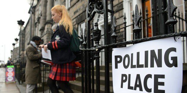 A young voter leaves a polling station after casting her vote in Edinburgh, Scotland, on September 18,...