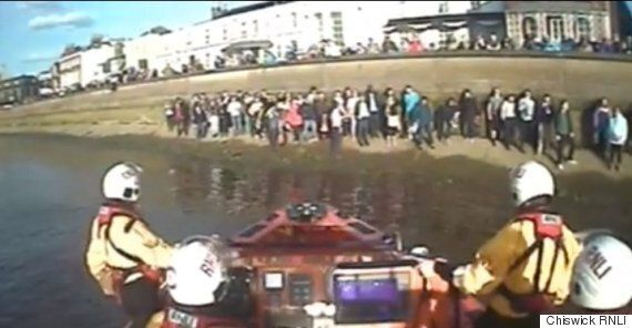 Boat Race Spectators Had To Be Rescued By Lifeboat After Rising River Thames Leaves Them