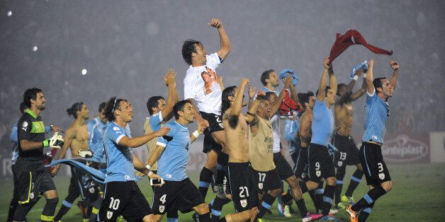 Uruguayan players celebrate after the end of the FIFA World Cup intercontinental play-offs 2nd Leg match...