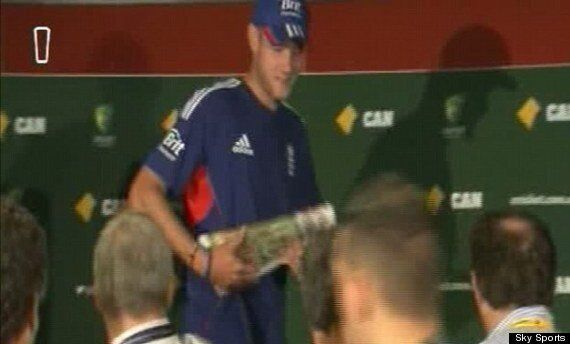 Stuart Broad Carries Copy Of Courier Mail After Ashes
