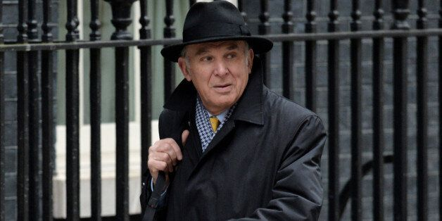Business Secretary Vince Cable arrives at Downing Street for the Cabinet meeting ahead of today's Budget,